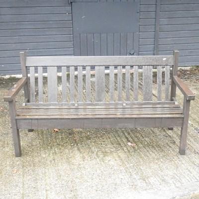 Lot 22 - A teak garden bench