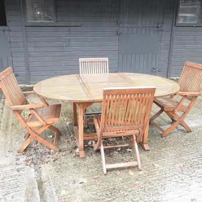 Lot 1 - A teak extending garden table