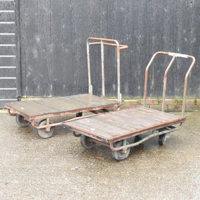 Lot 29 - Two flat bed trolleys, together with another