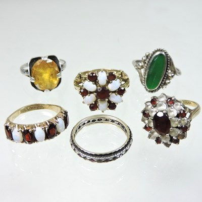 Lot 14 - A 9 carat gold garnet and opal cluster ring