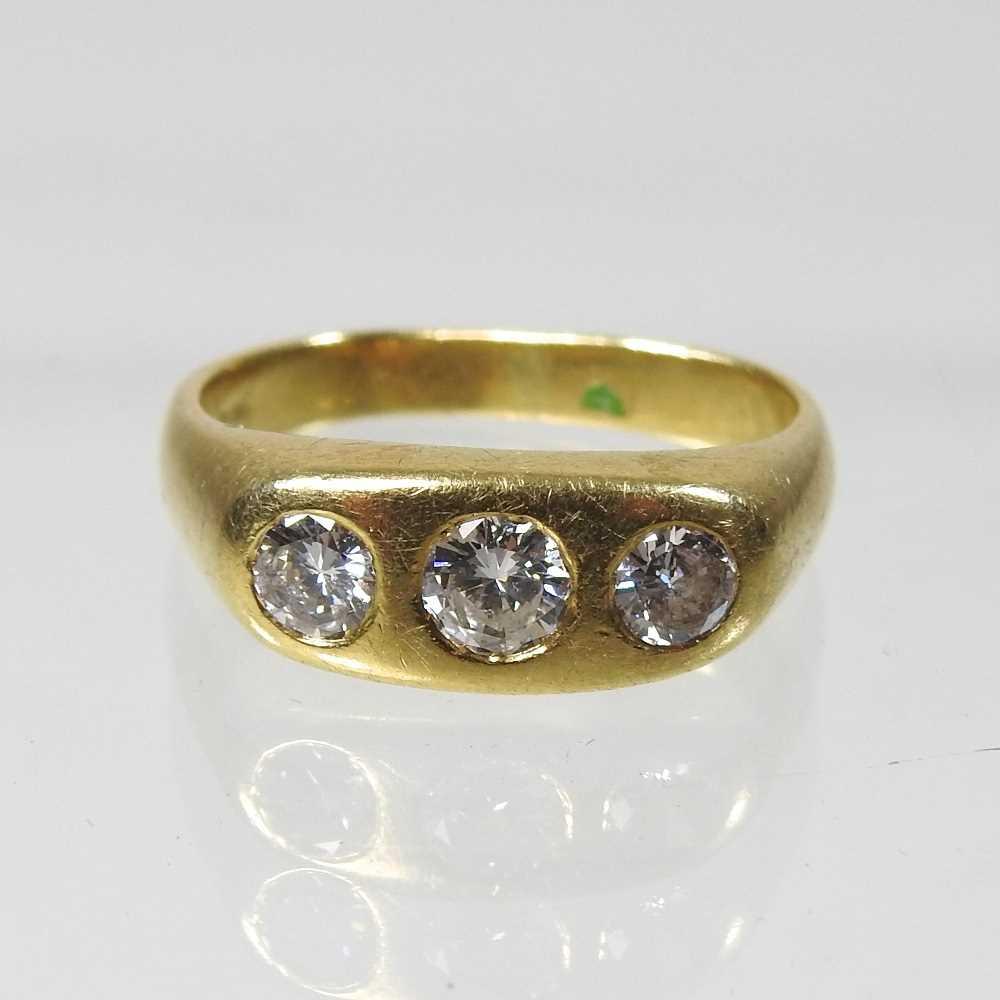 Lot 19 - An 18 carat gold three stone diamond ring