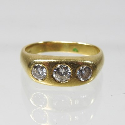 Lot 19 - An 18 carat gold three stone diamond ring