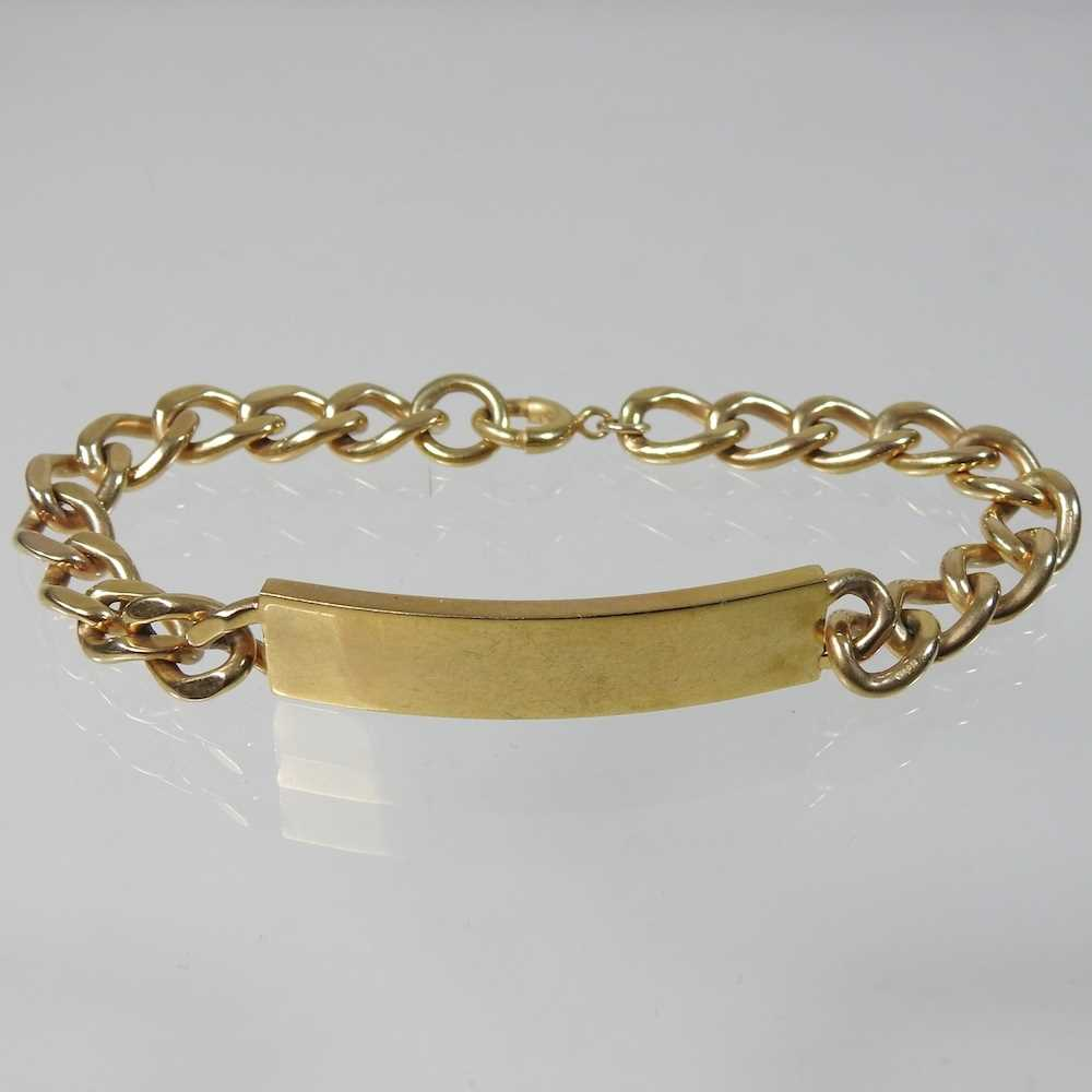 Lot 23 - A 9 carat gold gentleman's curb link bracelet