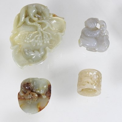 Lot 62 - An oriental jade coloured hardstone carving of a leaf