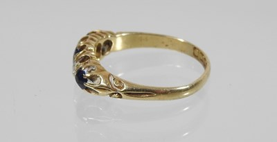 Lot 41 - An 18 carat gold five stone sapphire and diamond ring