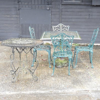 Lot 14 - A green painted cast iron garden table