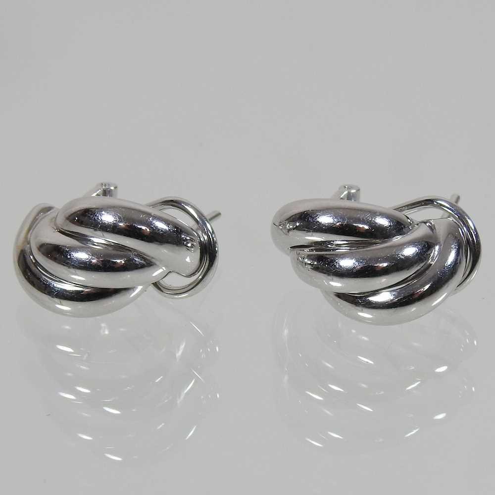 Lot 43 - A pair of 18 carat gold earrings