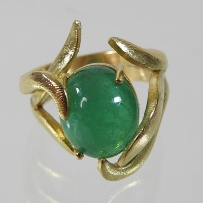 Lot 52 - A large 18 carat gold cabochon emerald ring