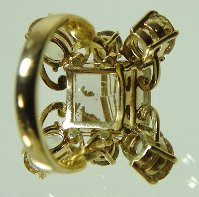 Lot 25 - An unmarked rutilated quartz seven stone cluster ring