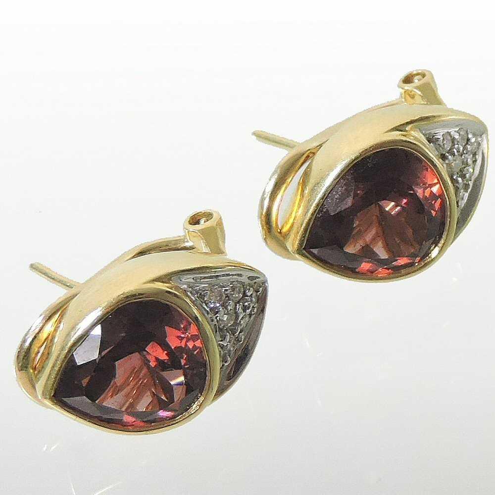 Lot 5 - A pair of 18 carat gold diamond and gem set earrings