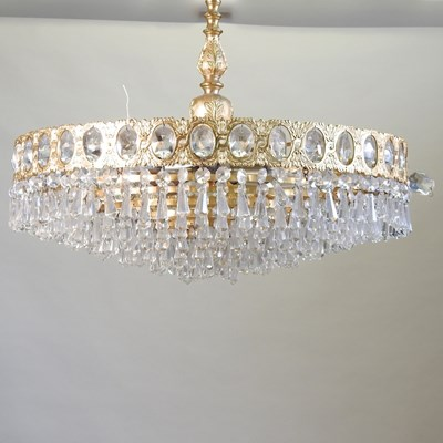 Lot 34 - A gold painted metal and cut glass chandelier