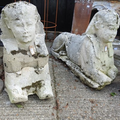 Lot 345 - A pair of 19th century carved stone sphinx