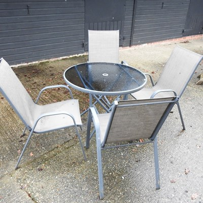 Lot 27 - A glass top circular garden table
