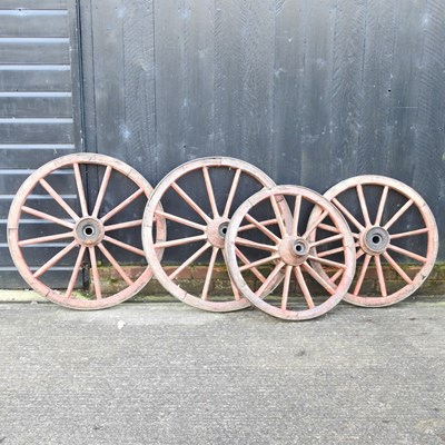 Lot 12 - A pair of red painted wooden cartwheels