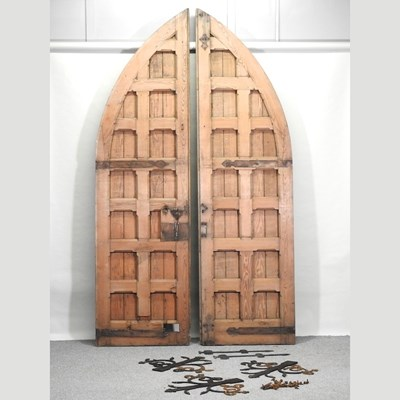 Lot 19 - A pair of large antique pitch pine gothic style doors
