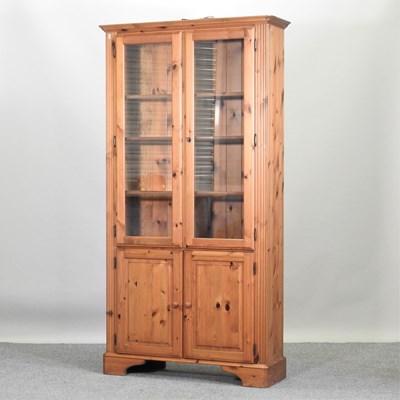 Lot 45 - A modern pine cabinet bookcase
