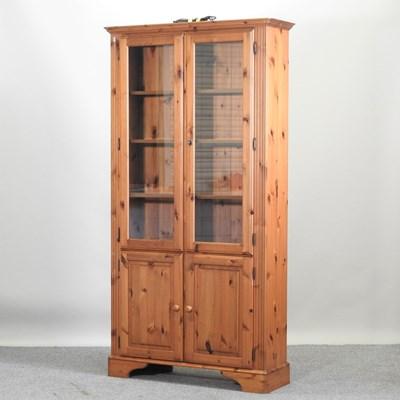 Lot 46 - A modern pine cabinet bookcase